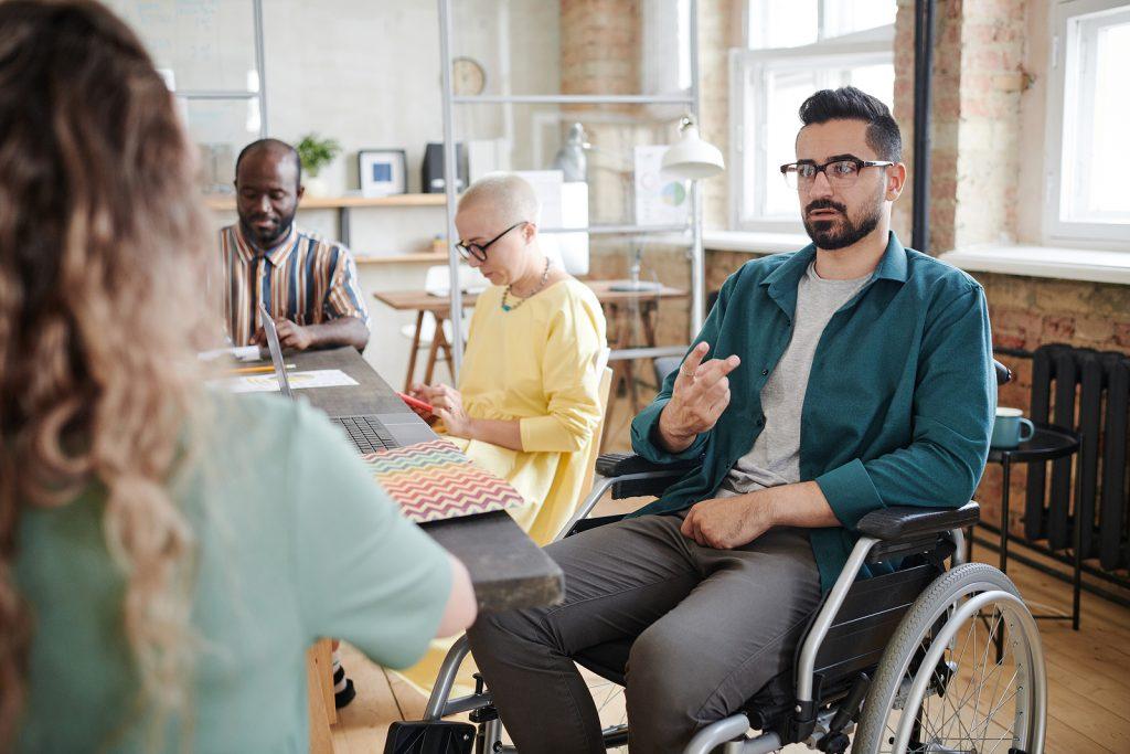 Disabled Businessman Sitting I 426595289
